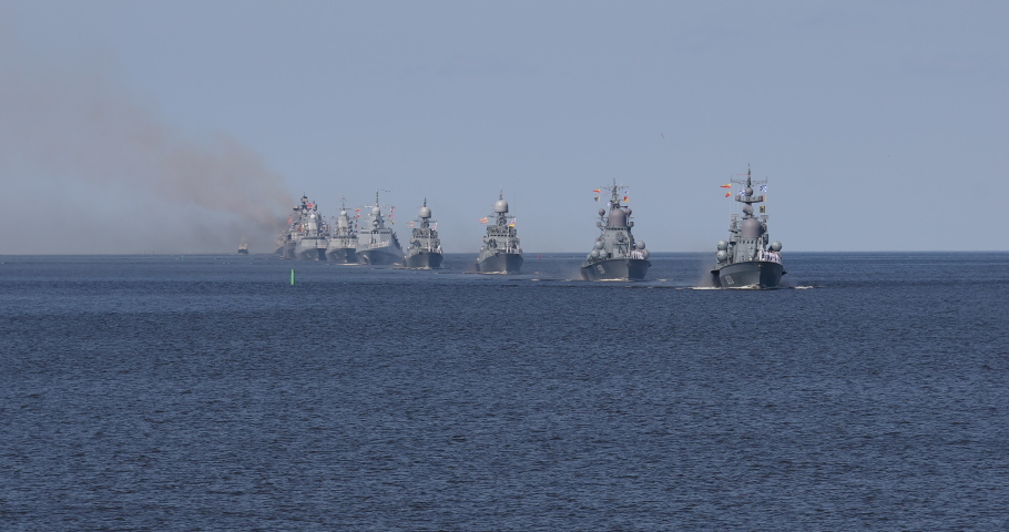 A line of modern russian military naval battleships warships in the row, northern fleet and baltic sea fleet in the open sea, summer sunny day  | Shutterstock HD Video #1034229086