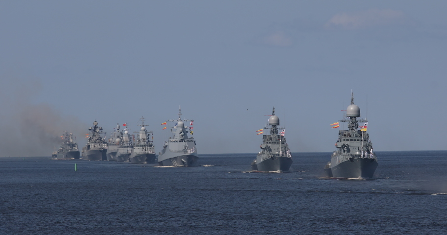 A line of modern russian military naval battleships warships in the row, northern fleet and baltic sea fleet in the open sea, summer sunny day  | Shutterstock HD Video #1034229104