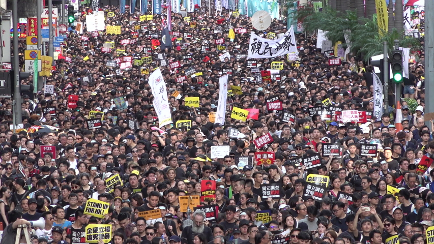 HONG KONG – 1 JULY 2019: Protesters occupy streets of central Hong Kong during massive demonstration against extradition bill and China's encroachment in the city