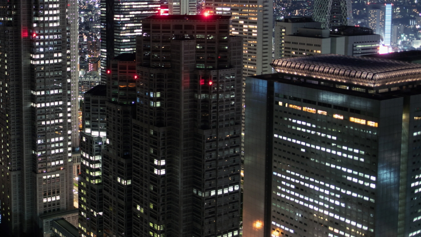 Time Lapse of the Big City Skyscrapers with Lights turning on. Day to Night Transition in the Megapolis.