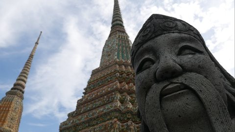 Time Lapse of Chinese sculpture in the temple of Reclining Buddha, Wat Pho, Bangkok. The temple is one of the oldest temples in Bangkok, and one of the most famous travel destinations in Thailand.
