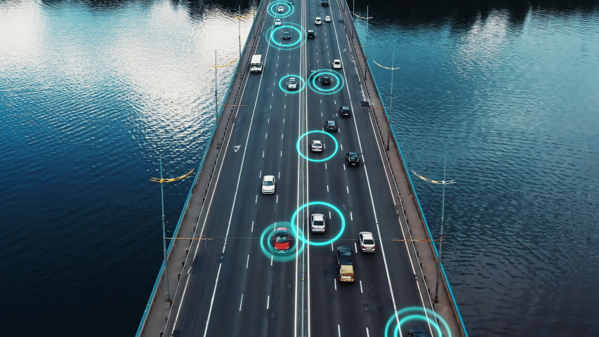 4K aerial drone footage self-driving autopilot cars driving with traffic passing-by on highway on the bridge. Artificial intelligence innovation detecting cars showing speed and driver's ID. Concept | Shutterstock HD Video #1034295590