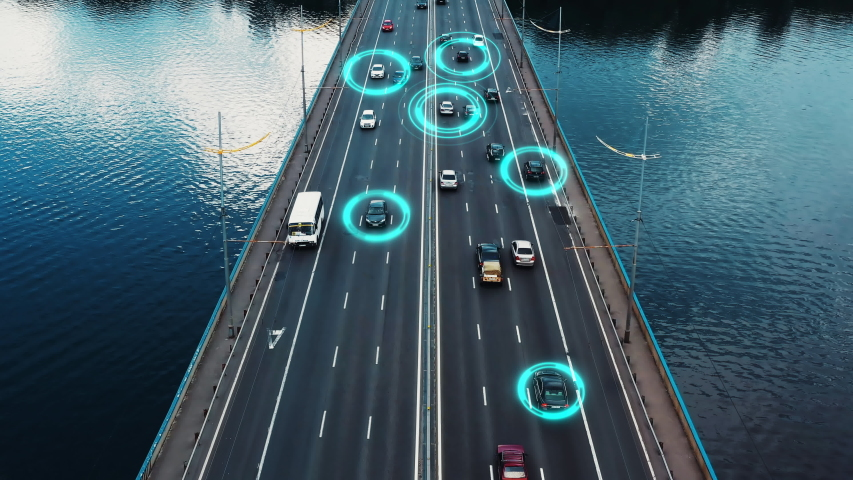 Self driving autonomous cars speeding through the bridge with technology scanning their speed. Artificial intelligence traffic surveillance system to provide safe driving avoid traffic jams. 4K aerial Royalty-Free Stock Footage #1034295596