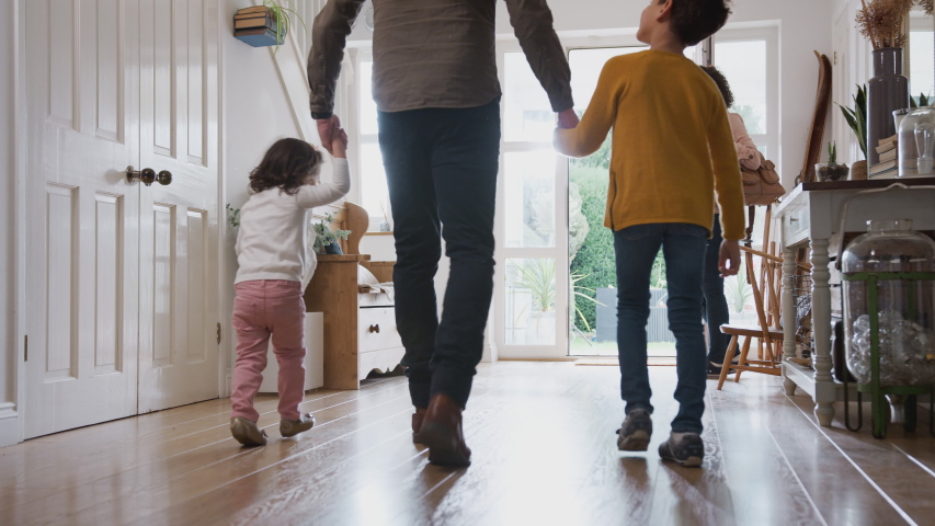 Rear View Of Family Leaving Home On Trip Out With Excited Children? | Shutterstock HD Video #1034298809