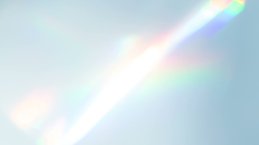 Diamond Creates a Bright Highlight. Loop. The light passes through the facets of a slowly rotating diamond and creates repetitive sparkling highlights and rainbow colors | Shutterstock HD Video #1034310245