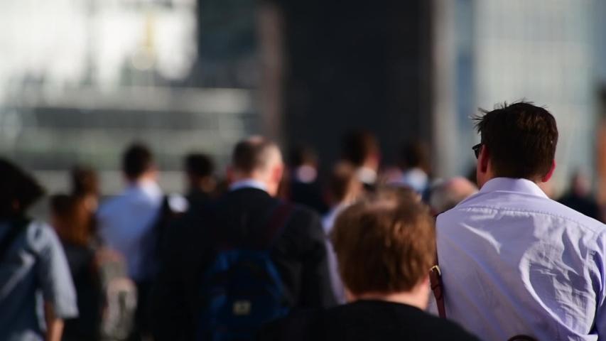 UK, England, London,Commuters walking to London Bridge Station SLOW MOTION #1034323784