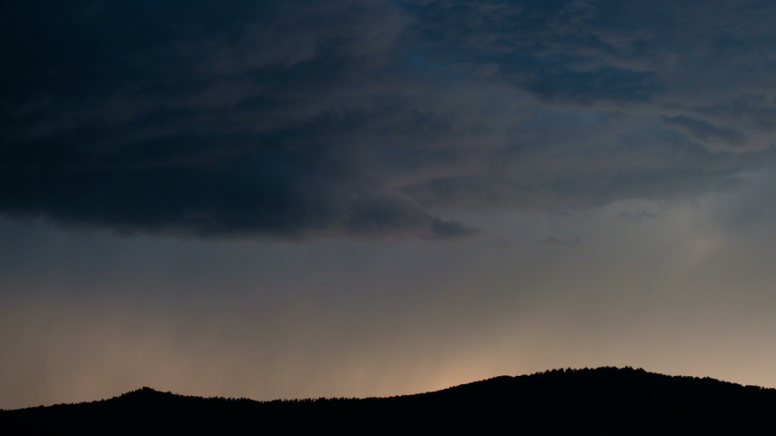 Evening sky with thunderclouds in the highlands. A bolt of lightning strikes the ground on the horizon. | Shutterstock HD Video #1034326370
