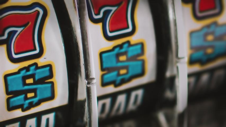 LAS VEGAS - MAY 7, 2019: Classic retro casino slot machine spinning winning jackpot closeup loop