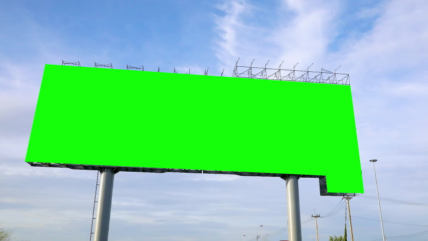 Time-lapse,Green screen of billboards on the sky background Large billboards on the road with green screens with white clouds in the sky | Shutterstock HD Video #1034348324