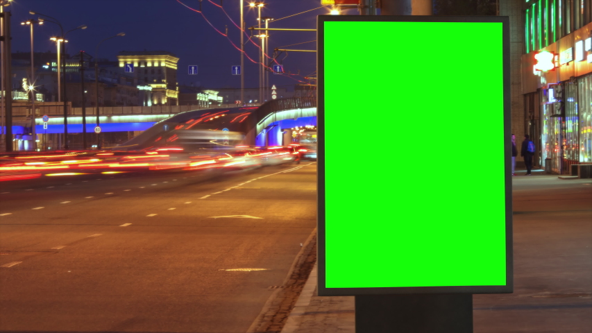 Modern billboard with a green screen on a busy highway with traffic, neon lights, timelapse of traffic at night, Moscow, Russia #1034353517