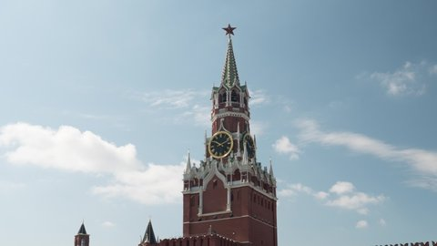 Moscow / Russia - 6/7/2019: Moscow Kremlin Clock Tower Hyperlapse Unique Timelapse in Red Square During Summer. Time Passes on Clock in Smooth Motion Wrapping Around Landmark