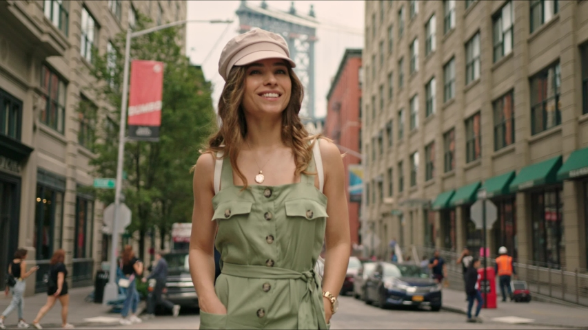 Pretty french lady walks around Manhattan. Moment from traveler's life. First time in New York. Famous views of big city. Enjoying the moment and feeling happy.   Shutterstock HD Video #1034429891