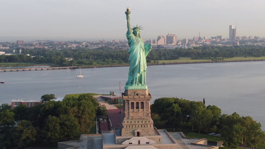 Super slow brief aerial Statue of Liberty; smooth, slow, cinematic; sunny morning | Shutterstock HD Video #1034447708