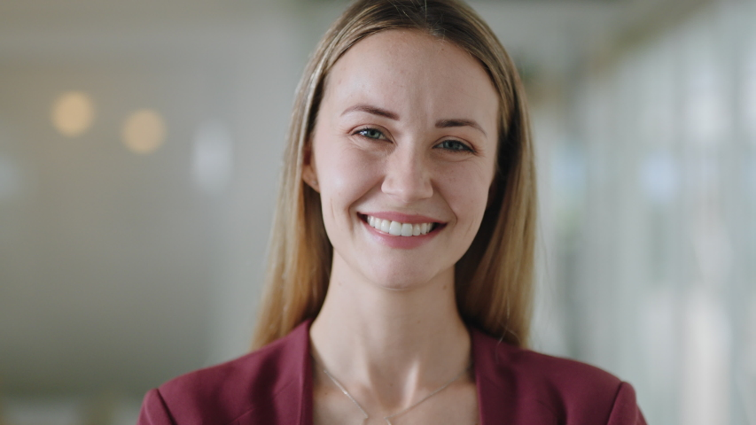 Portrait happy caucasian business woman smiling enjoying successful career proud entrepreneur in office workplace testimonial 4k footage