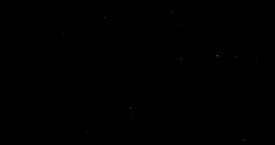 Flying dust particles on a black background   Shutterstock HD Video #1034450195