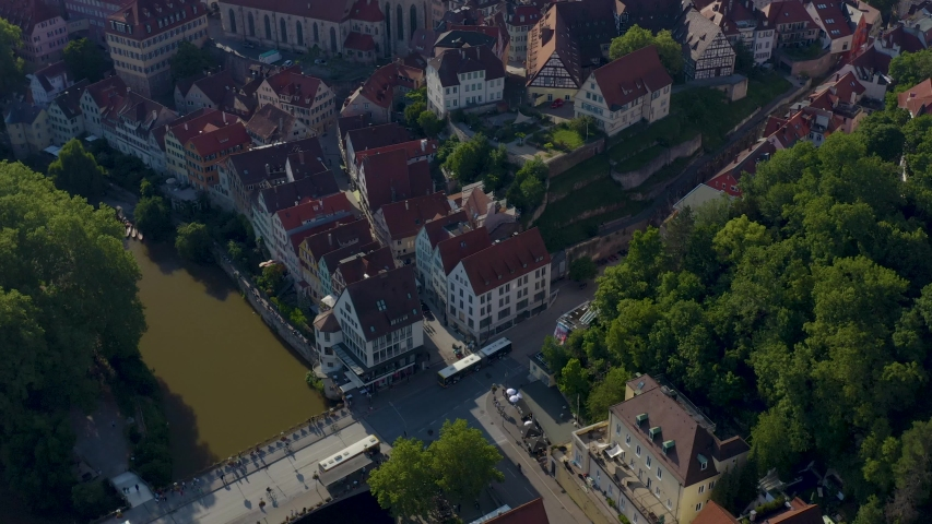 Aerial of the city Tübingen in Germany. Tilt up from bridge to old town. | Shutterstock HD Video #1034462876