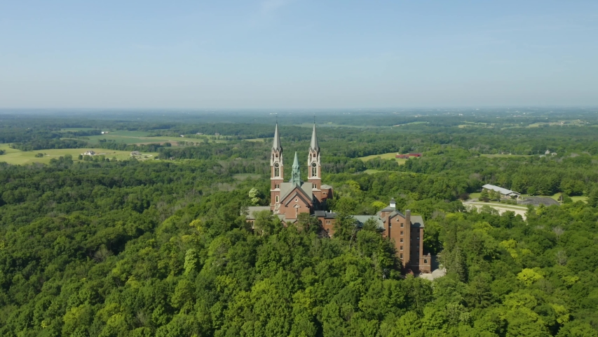 Holy Hill National Shrine of Mary, Wisconsin, USA, aerial view with flying forwards through the spires, drone footage.