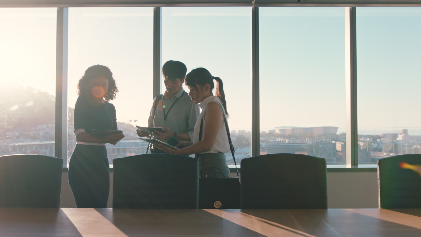 business people shaking hands consultant meeting international clients greeting with handshake planning partnership deal female executive working with shareholders in corporate office at sunset Royalty-Free Stock Footage #1034474534