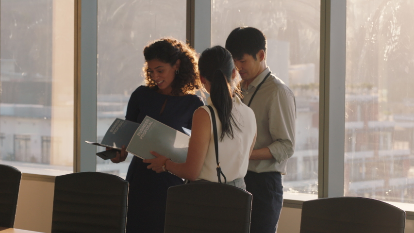 business people shaking hands consultant meeting international clients greeting with handshake planning partnership deal female executive working with shareholders in corporate office at sunset Royalty-Free Stock Footage #1034474570