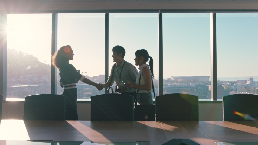 business people shaking hands consultant greeting international clients with handshake planning partnership deal female executive meeting shareholders in corporate office at sunset Royalty-Free Stock Footage #1034474609