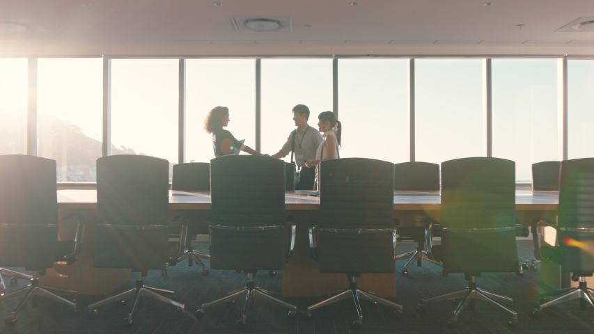 business people shaking hands consultant greeting international clients with handshake planning partnership deal female executive meeting shareholders in corporate office at sunset Royalty-Free Stock Footage #1034474612