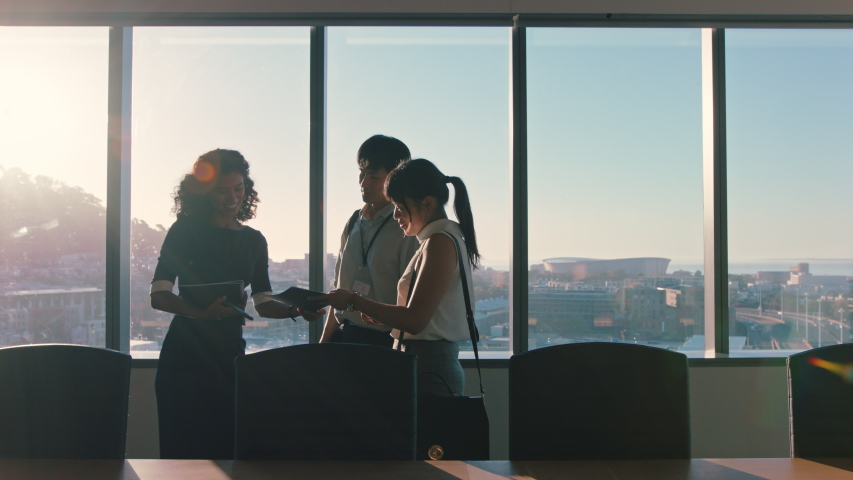 business people shaking hands consultant greeting international clients with handshake planning partnership deal female executive meeting shareholders in corporate office at sunset Royalty-Free Stock Footage #1034474615