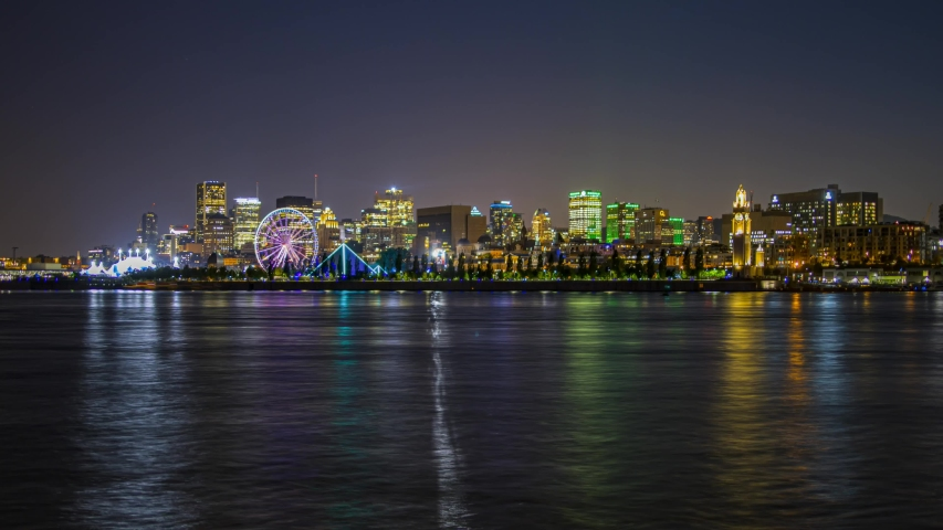 Night time lapse of Montreal old port with the Saint Lawrence river and a ferris wheel, Zoom in shot from Saint Helen's Island | Shutterstock HD Video #1034478164