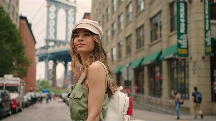 French tourist walks around Brooklyn and enjoying it, famous view on Manhattan Bridge, first time in New York, traveler's life.