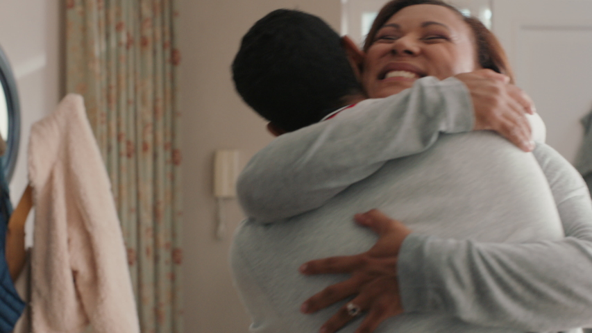 Happy teenage boy hugging mother congratulating son successful achievement excited mom feeling proud parent at home 4k footage