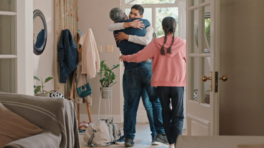 Young teenage boy arriving home surprising family hugging father and sister feeling excited enjoying surprise visit at home 4k | Shutterstock HD Video #1034487974