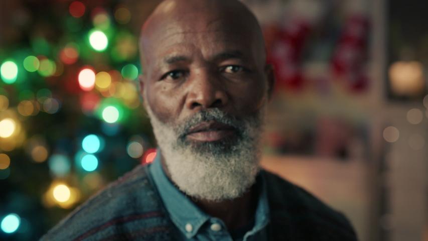 Portrait mature african american man celebrating christmas at home enjoying festive holiday season 4k | Shutterstock HD Video #1034490026