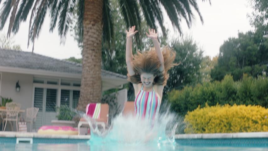 Happy woman jumping in swimming pool on warm summer day splashing enjoying summertime having fun summer vacation underwater view 4k footage | Shutterstock HD Video #1034499029