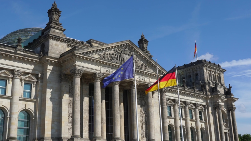 Berlin , Brandenburg / Germany - 07 19 2019: Flags in the wind at the Reichstag Building in Berlin
