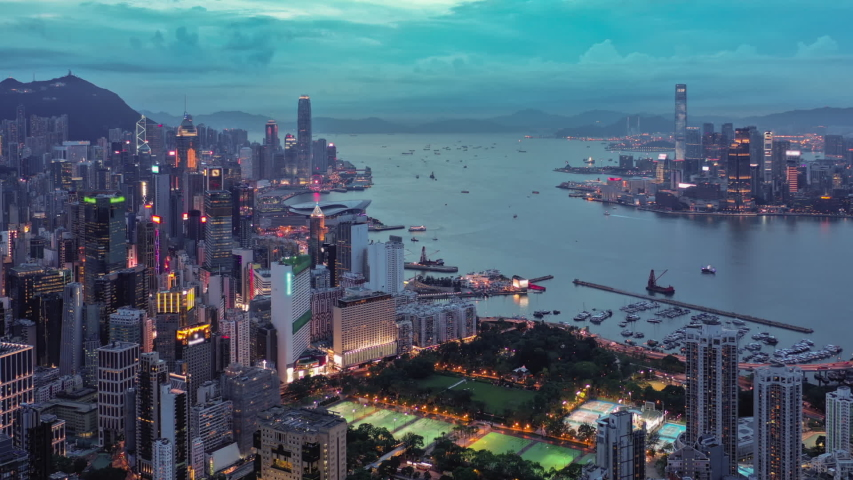 Aerial hyperlapse video of Victoria Harbour in Hong Kong at sunset | Shutterstock HD Video #1034523026
