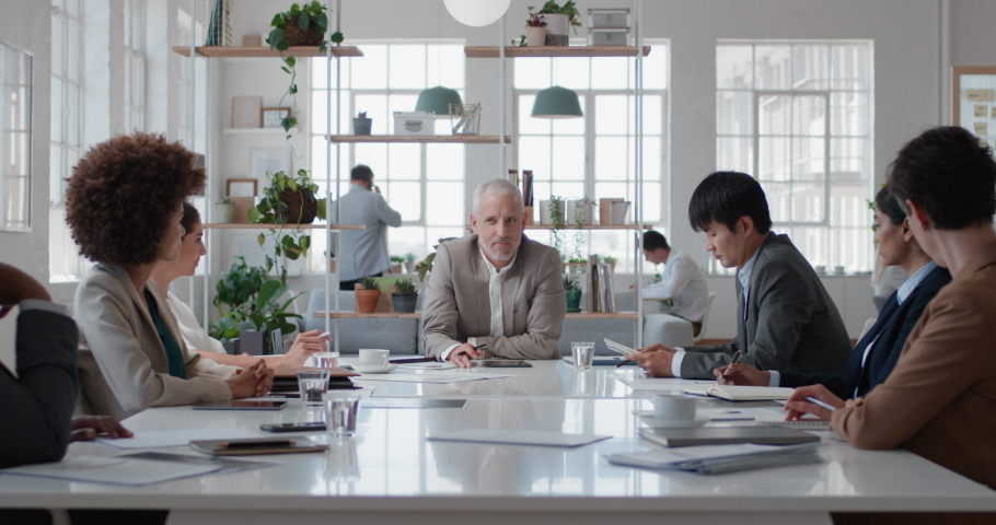 Mature businessman executive meeting corporate leaders discussing development ideas with shareholders brainstorming in office boardroom | Shutterstock HD Video #1034536190