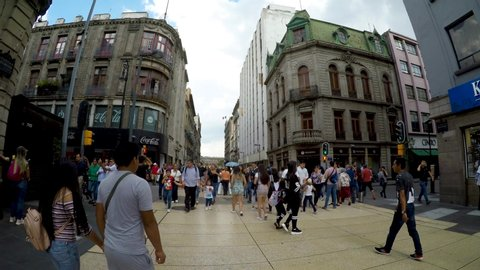 Mexico City, Mexico-July, 2019: People walking in the Madero street of Mexico City, this street is exclusively for pedestrian traffic giving access to the Constitution Square.