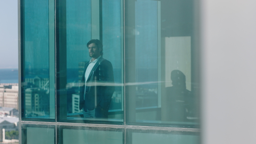 Successful businessman looking out window planning ahead thinking of future enjoying view of city 4k footage