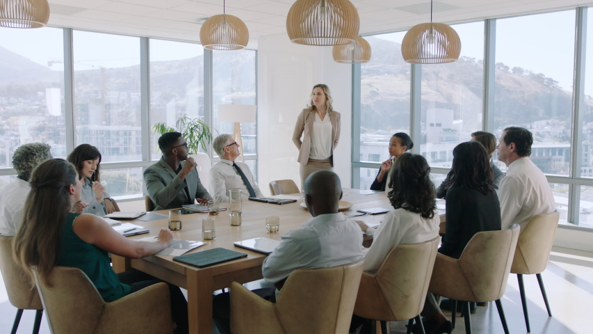 Beautiful business woman team leader discussing creative ideas with shareholders briefing colleagues sharing company development strategy in office boardroom meeting 4k | Shutterstock HD Video #1034542856