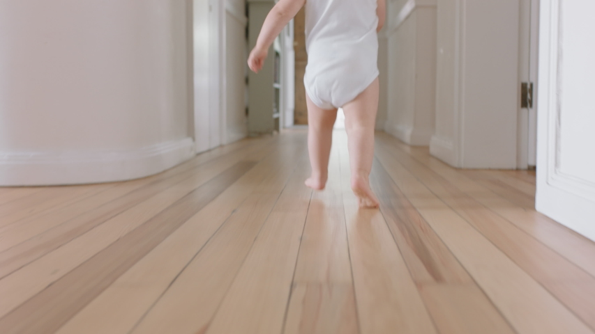 Baby boy learning to walk toddler exploring home curious infant walking through house enjoying childhood | Shutterstock HD Video #1034550050