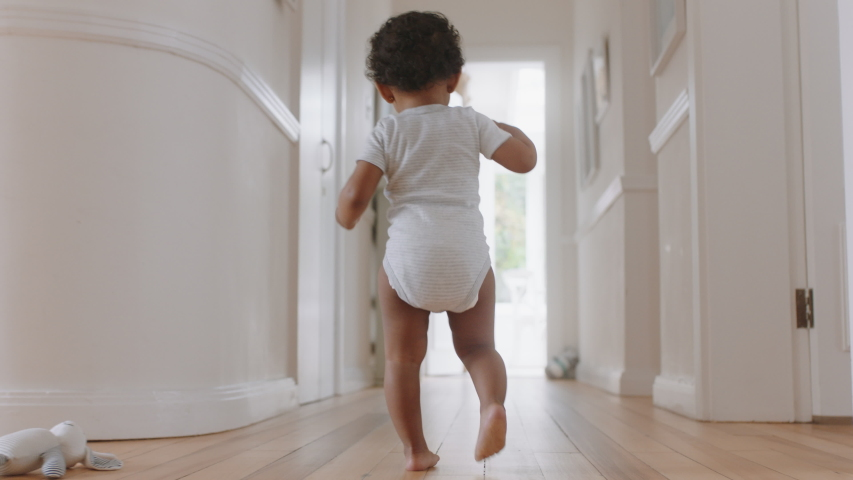 happy baby girl learning to walk toddler exploring home curious infant walking through house enjoying childhood Royalty-Free Stock Footage #1034551082