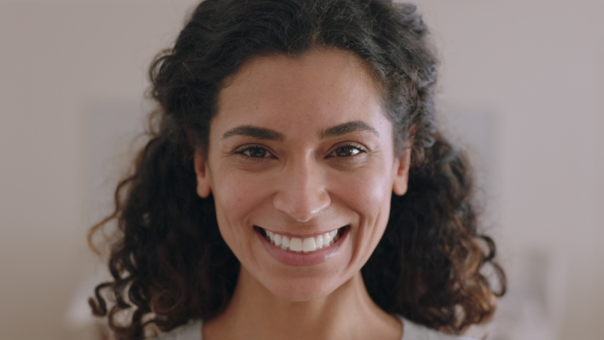 Portrait beautiful mixed race woman smiling 30's looking up at camera with happy emotion enjoying successful lifestyle