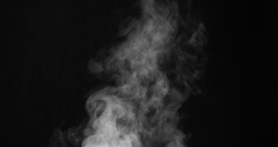 White Steam Ascends Over the Pan. White Steam rises from a large pot that is behind the scenes. Black background. Filmed at a speed of 120fps