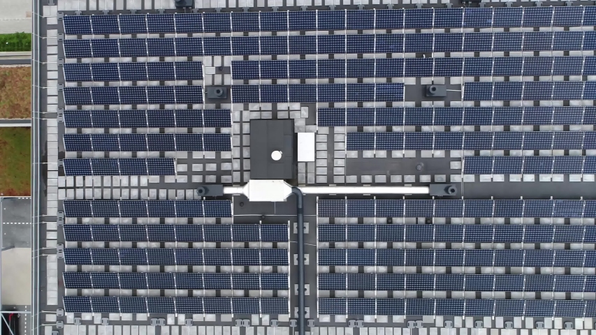 Aerial top down view of just finished modern neighborhood apartment building with solar panels on flat roof providing the residential part with renewable energy from the sun 4k high resolution Royalty-Free Stock Footage #1034596085