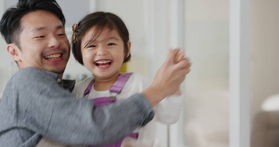 happy asian family dancing in kitchen father enjoying dance with daughter little girl laughing enjoying exciting weekend at home 4k footage Royalty-Free Stock Footage #1034597687