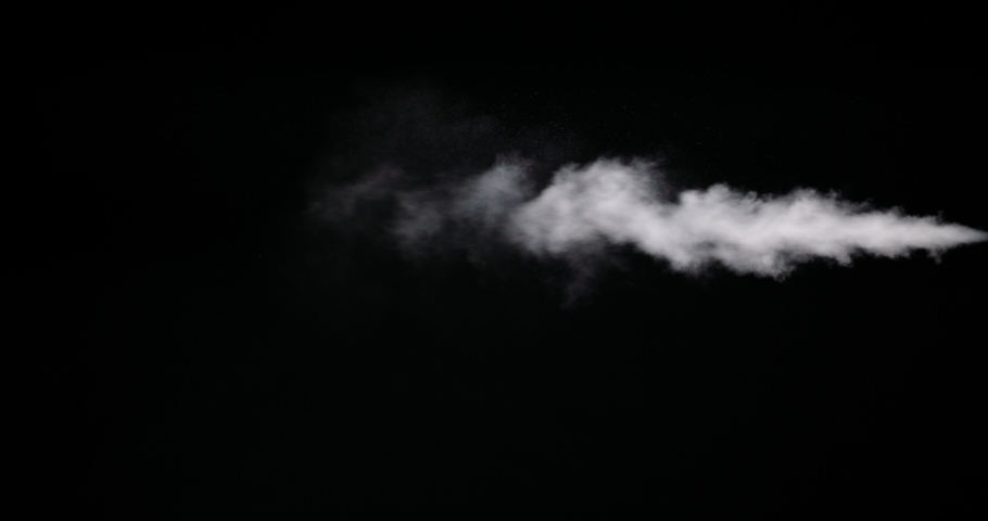 Real white smoke isolated on black background with visible droplets