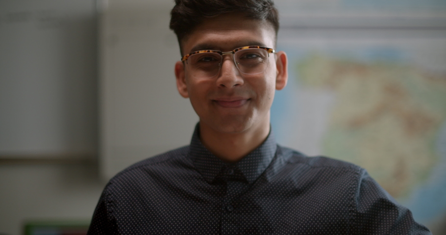 Portrait of student in classroom smiling surrounded by warm sunlight | Shutterstock HD Video #1034649782