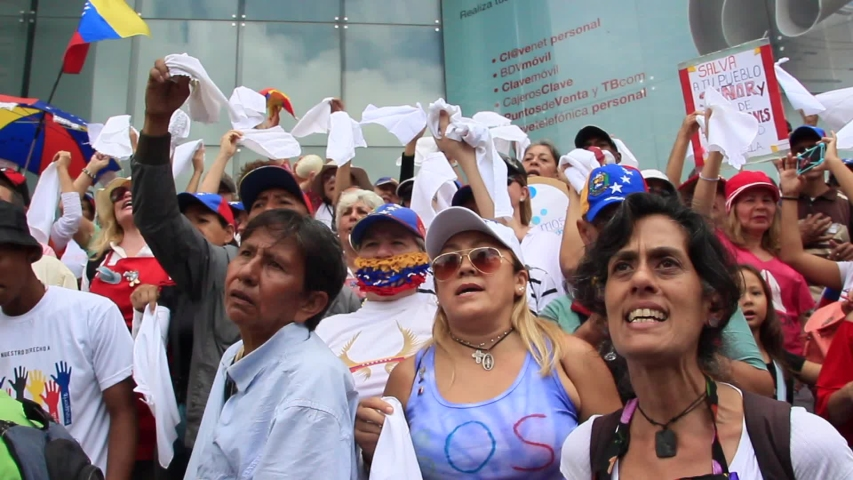 Caracas, Venezuela July 5, 2019: Venezuelans gather to protest on Independence Day, convened by opposition leader Juan Guaido. The motto of the protest was No more torture human rights violations