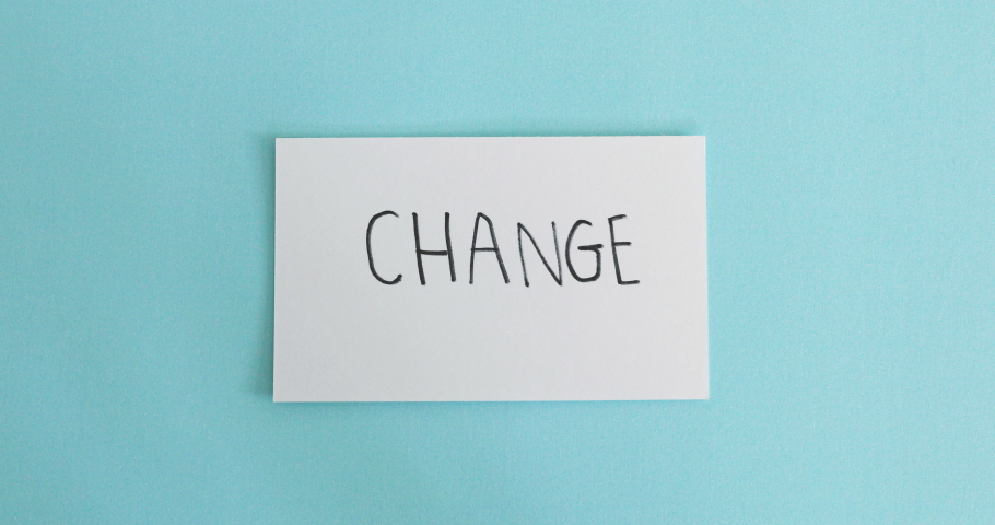 hand flip the paper card of  change  to chance word ,motivation for changing mindset from negative to positive concept Royalty-Free Stock Footage #1034650706