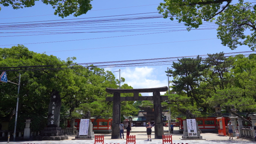 Fukuoka, Japan - July 15, 2019: Establishing shot of Japanese passing by entrance of Hakozaki Shrine | Shutterstock HD Video #1034661482