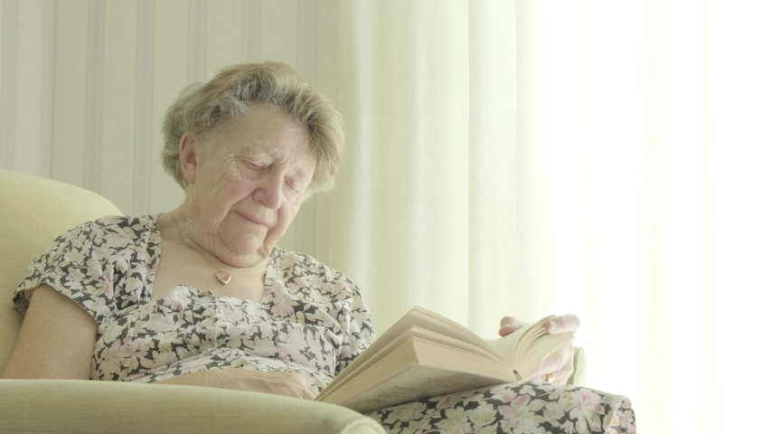Senior caucasian woman reading a book themes of retired pensioner reading hobbies